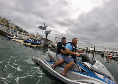 Father and son jet ski together